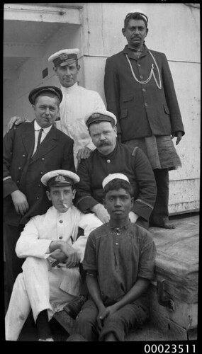 Four men in naval attire and two men, possibly in Indian dress