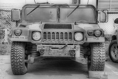 off-roading(0.0), armored car(1.0), automobile(1.0), automotive exterior(1.0), military vehicle(1.0), sport utility vehicle(1.0), vehicle(1.0), hummer h1(1.0), humvee(1.0), monochrome photography(1.0), off-road vehicle(1.0), bumper(1.0), land vehicle(1.0), monochrome(1.0), luxury vehicle(1.0), black-and-white(1.0), motor vehicle(1.0),