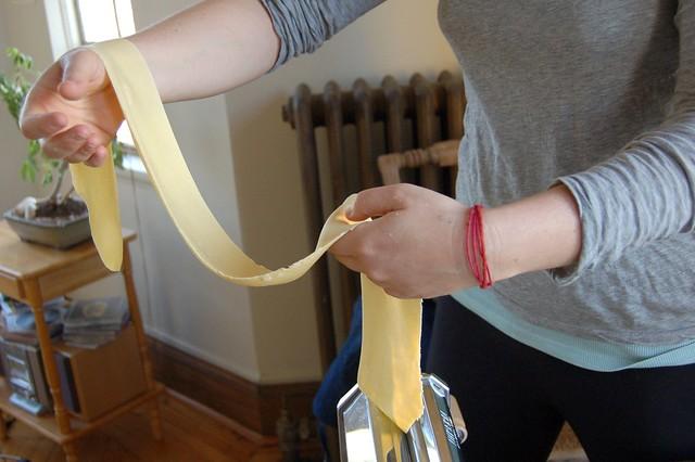 Putting the dough through a final time to flatten even more