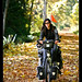 Ivana cycling over fall leaves