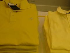 sleeve(0.0), clothing(1.0), collar(1.0), yellow(1.0), outerwear(1.0), polo shirt(1.0), shirt(1.0), t-shirt(1.0),