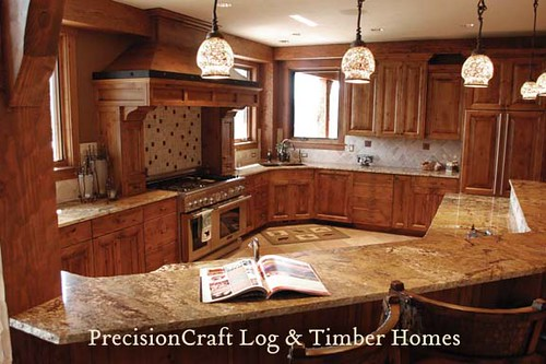 Kitchen & Island View | Custom Timber Home | PrecisionCraft Timber Homes