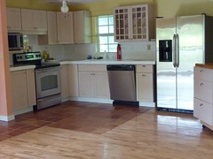 cuisine classique(0.0), floor(1.0), kitchen(1.0), countertop(1.0), wood(1.0), room(1.0), property(1.0), wood stain(1.0), laminate flooring(1.0), wood flooring(1.0), real estate(1.0), hardwood(1.0), cabinetry(1.0), home(1.0), flooring(1.0),