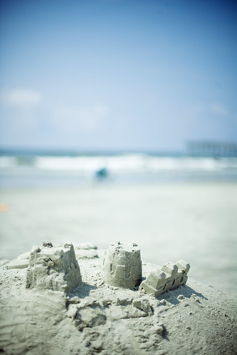 ocean blue sky castle beach clouds sand sandcastle