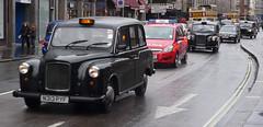 sedan(0.0), automobile(1.0), vehicle(1.0), austin fx4(1.0), transport(1.0), mode of transport(1.0), antique car(1.0), vintage car(1.0), land vehicle(1.0), luxury vehicle(1.0), motor vehicle(1.0),