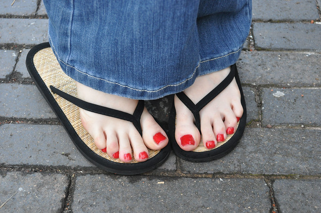 Woman Wearing Blue Jeans And Flip Flops #1 Stock Photo