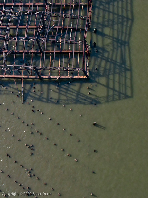 Bent skeletal warehouse remains stand in Hudson River at 63rd Street