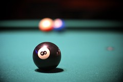 purple(0.0), recreation(0.0), cue stick(0.0), indoor games and sports(1.0), sports(1.0), nine-ball(1.0), pool(1.0), macro photography(1.0), games(1.0), carom billiards(1.0), billiard ball(1.0), eight ball(1.0), close-up(1.0), circle(1.0), english billiards(1.0), black(1.0), ball(1.0), cue sports(1.0),