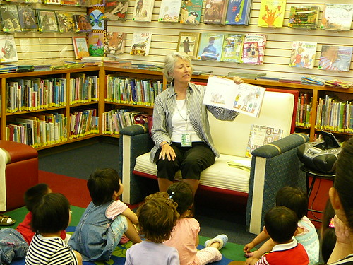 Debbie reading to children during Lapsit Storytime.
