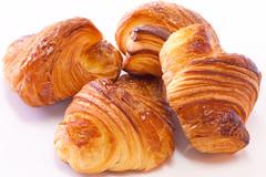tsoureki(0.0), pain au chocolat(0.0), dessert(0.0), baked goods(1.0), food(1.0), viennoiserie(1.0), cuisine(1.0), danish pastry(1.0), croissant(1.0),