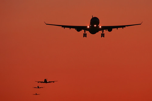 orange sunrise airplane aircraft aviation jet landing civil airbus boeing approach 747 a330 jumbo winglets