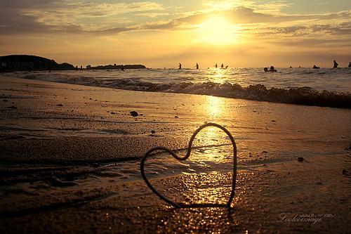 ocean china sunset sea vacation love beach heart shandong weihai loolooimage