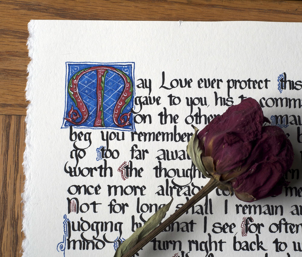 Dante love poem in medieval calligraphy a photo on