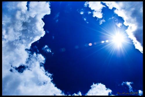 blue sky sun clouds noon bight