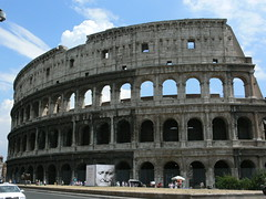bullring(0.0), palace(0.0), baptistery(0.0), ancient greek temple(0.0), roman temple(0.0), triumphal arch(0.0), amphitheatre(1.0), classical architecture(1.0), ancient roman architecture(1.0), arch(1.0), ancient history(1.0), tourism(1.0), landmark(1.0), architecture(1.0), ancient rome(1.0), facade(1.0),