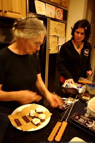 rachel & anna preparing stovetop s'mores for dessert    MG 3637