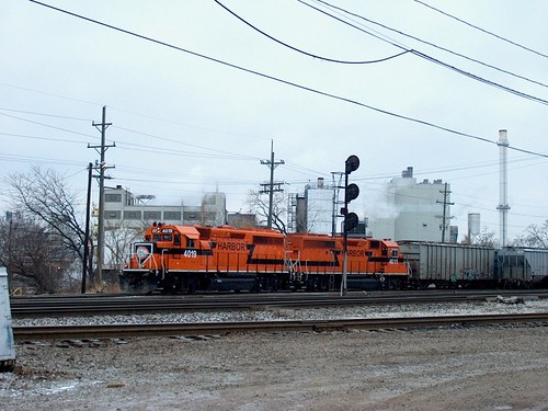 Orange Indiana Harbor Belt EMD roadswitchers at work inside Argo Yard. Summit Illinois. January 2007. by Eddie from Chicago