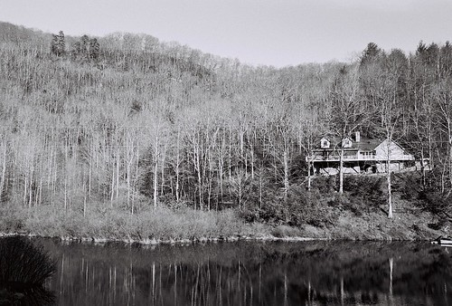bw house lake tree film nikon scanned vegetation delta100 n80 nikonn80 ilford artificiallandscape flickrpublic gtpc afnikkor35mmf2d 4rating 350mmf20 e6lab roll00001