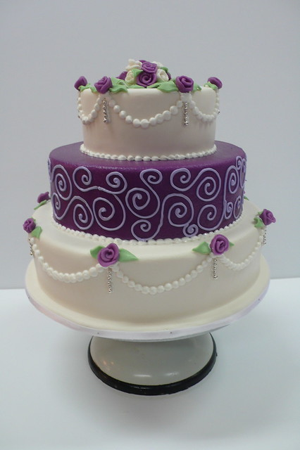 Classic purple and white wedding cake with marzipan roses - Purple cake decorating ideas ...