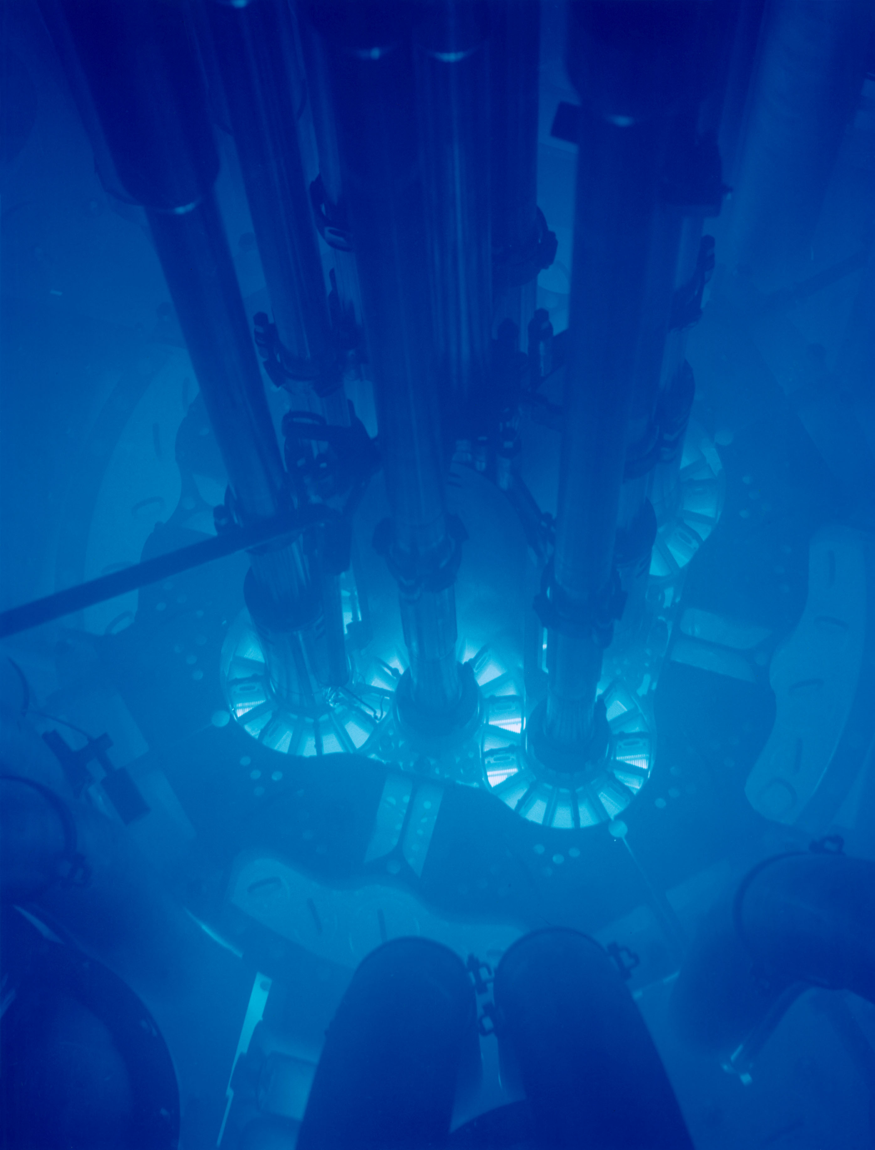 Advanced Test Reactor core, Idaho National Laboratory, submerged in water and glowing even bluer from Cherenkov Radiation. [2,791 × 3,668]
