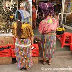 Indigenous Women Looking at Shoes - Xela, Guatemala