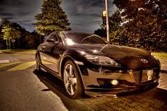 automobile(1.0), wheel(1.0), vehicle(1.0), performance car(1.0), automotive design(1.0), mazda(1.0), land vehicle(1.0), luxury vehicle(1.0), mazda rx-8(1.0), sports car(1.0),