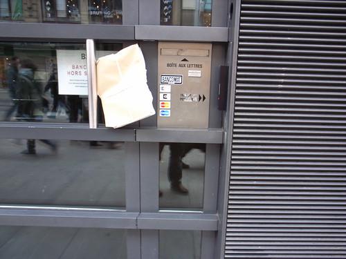Door handle as letter-box
