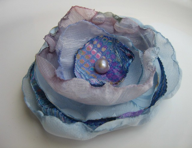 blue rose hair clip Fun blue violet fabrics with a mauve pearl in the