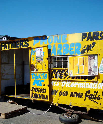 Image of a barber and phone shop in Langa