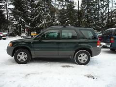 ford escape hybrid(0.0), automobile(1.0), automotive exterior(1.0), sport utility vehicle(1.0), vehicle(1.0), compact sport utility vehicle(1.0), crossover suv(1.0), mazda tribute(1.0), ford escape(1.0), land vehicle(1.0),
