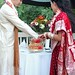 urmila and brian cutting thier cake. The top layer was gluten free for the bride