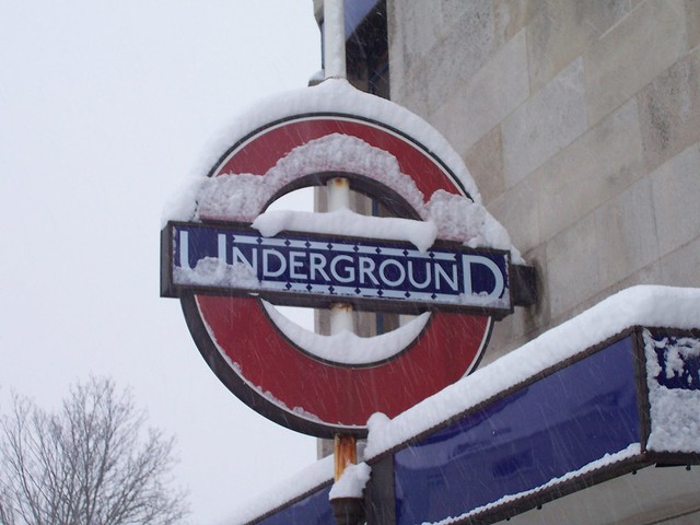 Snow topped Underground sign at Colliers Wood
