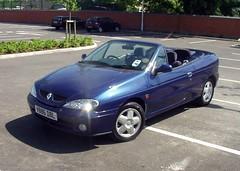 family car(0.0), automobile(1.0), automotive exterior(1.0), vehicle(1.0), compact car(1.0), renault mã©gane(1.0), bumper(1.0), sedan(1.0), land vehicle(1.0), convertible(1.0),