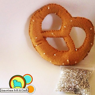 Sugar #beads aren't salt but they play them on this #felt #pretzel #photoshoot #smallbusiness #diy