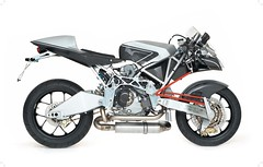automotive exterior(0.0), bumper(0.0), supermoto(0.0), automobile(1.0), wheel(1.0), vehicle(1.0), exhaust system(1.0), motorcycle(1.0),