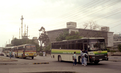Saulog Transit Inc Hino DGJ-518 (fleet No 604), Trifmann Hino DVS-749 (fleet No 41424) in the Lawton area of Manila, Philippines.