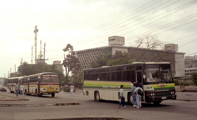 Saulog Transit Inc Hino DGJ-518 (fleet No 604), Trifmann Hino DVS-749 (fleet No 41424) in the Lawton area of Manila, Philippines.
