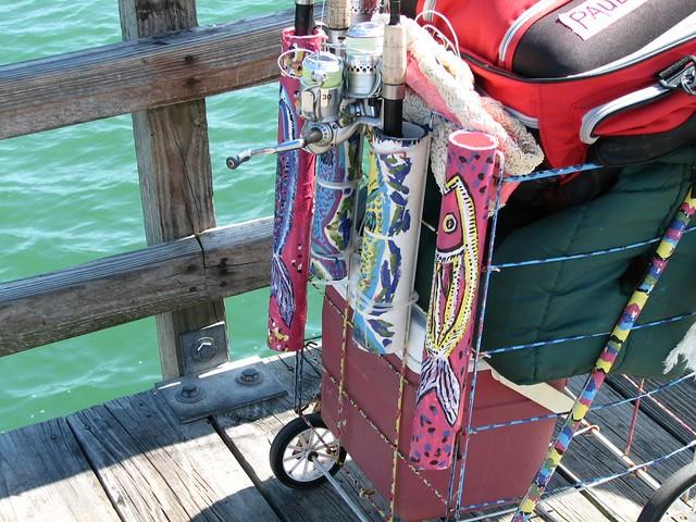 Fancy fishing pole holders naples pier by mebrett for Pier fishing rod holder