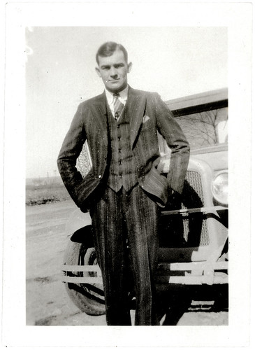 Newell Robertson Striped suit and car