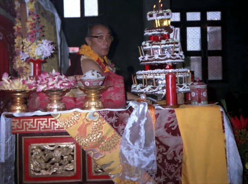 1990 Lam Dre, His Holiness Jigdal Dagchen Sakya Rinpoche with his birthday cake offering mandala, long life rice, and flowers, very fancy silks, with pink, purple, gold dragons, flowers, on his throne, Tharlam Monastery, Boudha, Kathmandu, Nepal by Wonderlane