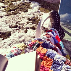 #Reading in the sun; pretending it is #Spring. #snow #lawnchair #picoftheday