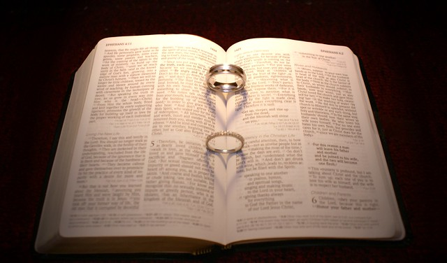 This is our wedding rings placed in the bible opened to Ephesians 5 which