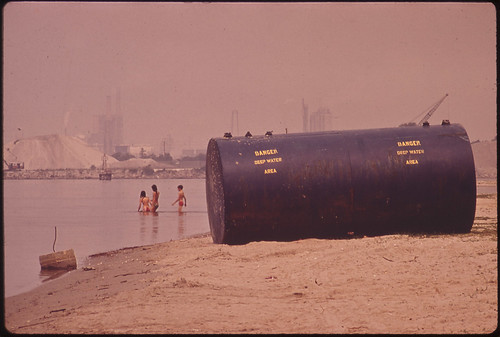 Chemical storage tank on beach, Documerica photo by Marc St-Gil June, 1972