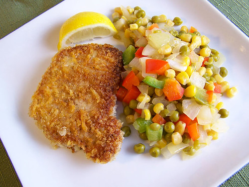 Asiago-Crusted Pork Chops with Sweet Pea and Pepper Toss
