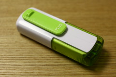 mobile phone(0.0), electronic device(1.0), data storage device(1.0), green(1.0), gadget(1.0), usb flash drive(1.0),