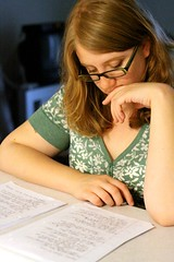 adolescence, hand, glasses, arm, writing, reading, brown hair, homework, person, adult,