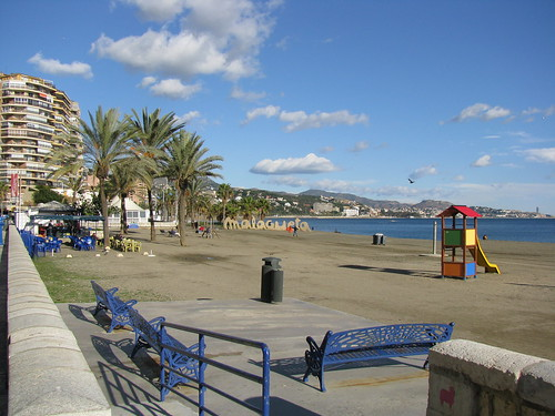 Blue benches on Malagueta Beach, Malaga, Spain