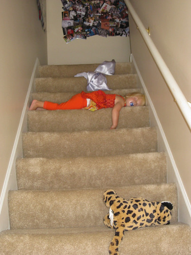 Micah sleeping on the stairs