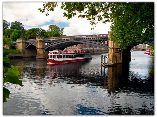 Sightseeing cruise boat under Skeldergate Bridge......