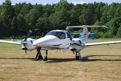 military aircraft(0.0), north american t-28 trojan(0.0), flight(0.0), air force(0.0), monoplane(1.0), diamond da42(1.0), aviation(1.0), airplane(1.0), propeller driven aircraft(1.0), vehicle(1.0), ultralight aviation(1.0), aircraft engine(1.0),